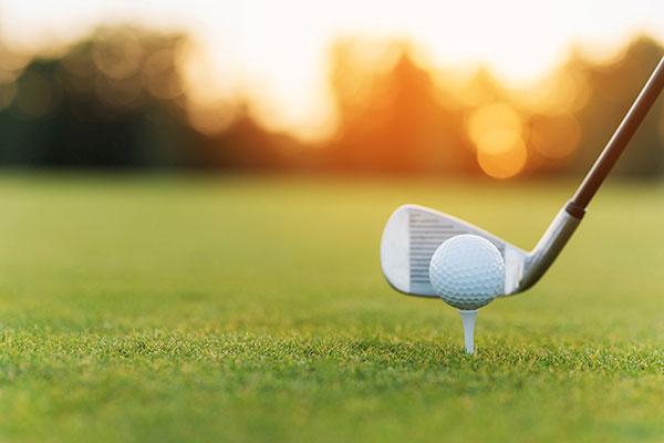 golf-ball-on-tee-playing-sports-on-green-fairway
