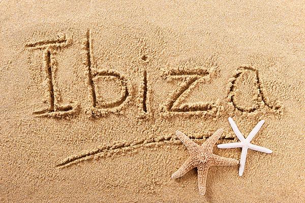 ibiza-spain-beach-sand-sign